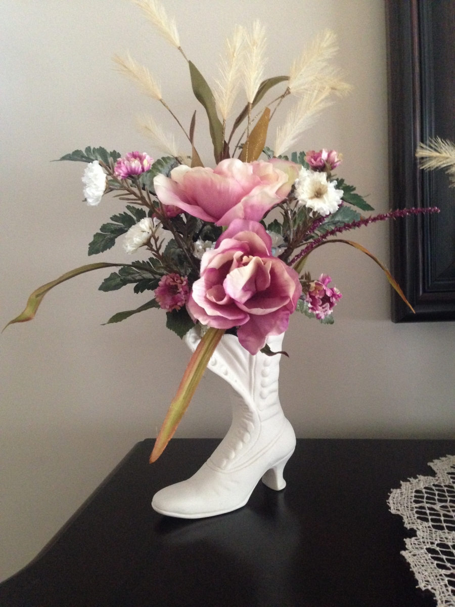 Roses in old-fashioned shoe